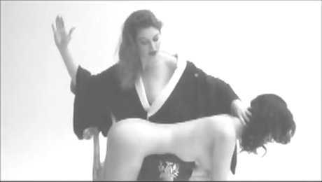 Delicious dominatrix slaps a beautiful busty girl